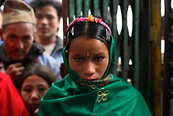 A nine-months pregnant Niruta, 14, arrives at the wedding ceremony in Kagati Village, Kathmandu Valley, Nepal on Jan. 23 ,2007. Niruta moved in with the family of Durga, 17, and became pregnant when they were only engaged. In some circles of the more socially open Newar people, this is permissible. ropensity towards this practice.