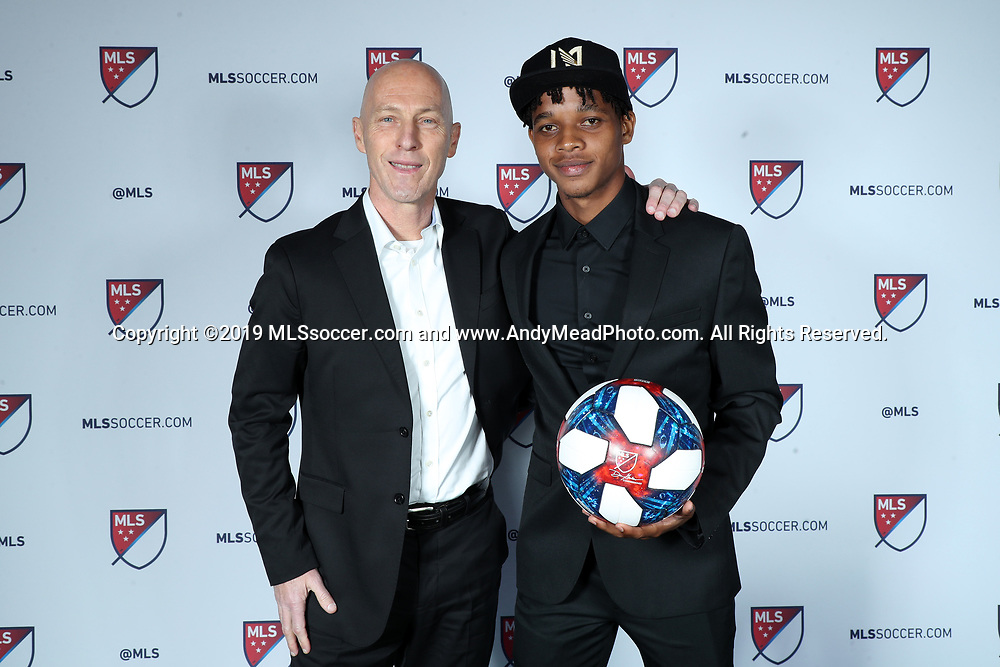 CHICAGO, IL - JANUARY 11: Peter-Lee Vassell was taken with the 40th overall pick by Los Angeles FC. With head coach Bob Bradley (left). The MLS SuperDraft 2019 presented by adidas was held on January 11, 2019 at McCormick Place in Chicago, IL.