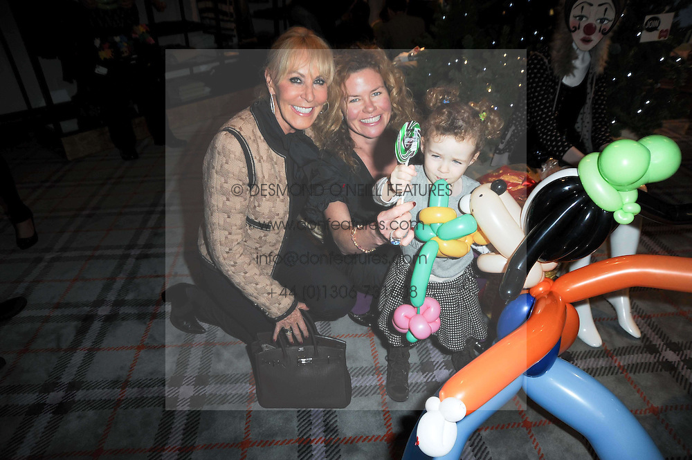 Left to right, MRS DAVID MORRIS, her daughter ERIN MORRIS and SKYE MORRIS at the Juicy Couture children's tea party in aid of Mothers 4 Children held at the Juicy Couture Store, Bruton Street, London on2nd December 2009.