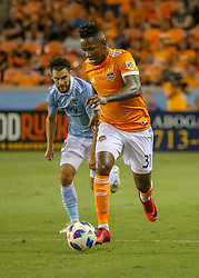 August 4, 2018 - Houston, TX, U.S. - HOUSTON, TX - AUGUST 04:  Houston Dynamo forward Romell Quioto (31) keeps the ball away from Sporting Kansas City midfielder Graham Zusi (8) during the soccer match between Sporting Kansas City and Houston Dynamo on August 4, 2018 at BBVA Compass Stadium in Houston, Texas.  (Photo by Leslie Plaza Johnson/Icon Sportswire) (Credit Image: © Leslie Plaza Johnson/Icon SMI via ZUMA Press)