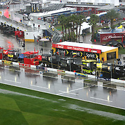 A wet pit road remains empty after a red flag is thrown due to rain during the 56th Annual NASCAR Daytona 500 practice session at Daytona International Speedway on Saturday, February 22, 2014 in Daytona Beach, Florida.  (AP Photo/Alex Menendez)