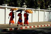 Although Vientiane is not known for its  temples and hundreds of monks wandering around like Luang Prabang, it still has more than its share of temples and monks, coming and going from schools, temples, chanting ceremonies and early morning alms visits.