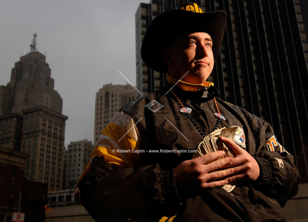 """""""There's a lot of pride to take with your team. Pittsburgh is associated so strongly with the Stealers that you just feel like you are part of the team. To experience the pinnacle moment, to see them perform at their biggest game...emotions will last a lifetime...you can always make more money!"""" ..Michael Malinowski, 22, of Pittsburgh, PA is willing to spend $2,000 in cash for Super Bowl tickets.   (Robert Caplin For The New York Times).."""