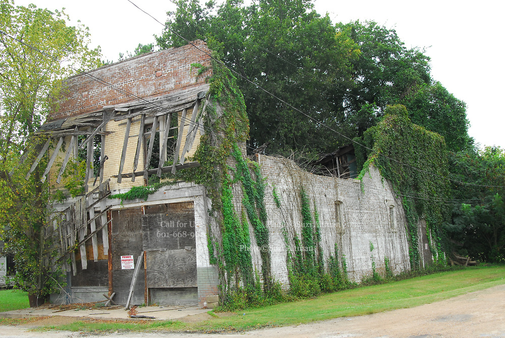 The old Bryant Store in Money, MS. from The old Bryant store is just over his shoulder, it has stood the test of time but is in bad shape and decaying. The store is where Emmett Till a young black man from chicago who stopped in the store and whistled or cat called at the oweners blonde and white wife,Emmett was later found lynched and the men who were accused of the crime were found not guilty.The store owners was Roy Bryant it was his wife that was whistled at and Roy owned the store with his half brother J.W.Milam in 1955. Bryant and Milam were indicted for kidnapping and lynching Till but were later acquited of all charges.(photo/Suzi Altman)
