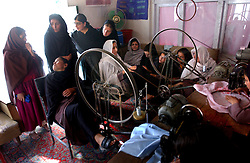 KABUL,AFGHANISTAN - SEPT. 10:  Afghan girls learn embroidery using machines made out of bicycles to power the sewing machines September 10, 2002 in Kabul, Afghanistan. (Photo by Ami Vitale/Getty Images)