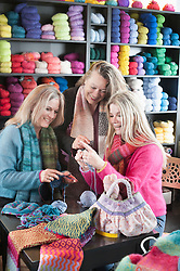 Knitting teacher with two women in knitting lesson, Bavaria, Germany