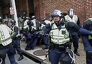 Virginia State Police arrest a demonstrator at the corner of Fourth and Water Street Sunday on the anniversary of August 12th. Photo/Andrew Shurtleff