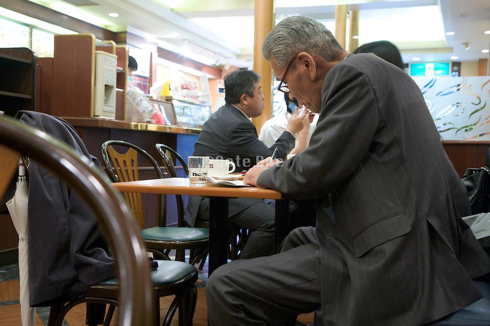 senior businessman in a coffee bar Tokyo Japan