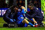 AFC Wimbledon midfielder Dylan Connolly (16) down injured during the The FA Cup match between AFC Wimbledon and West Ham United at the Cherry Red Records Stadium, Kingston, England on 26 January 2019.