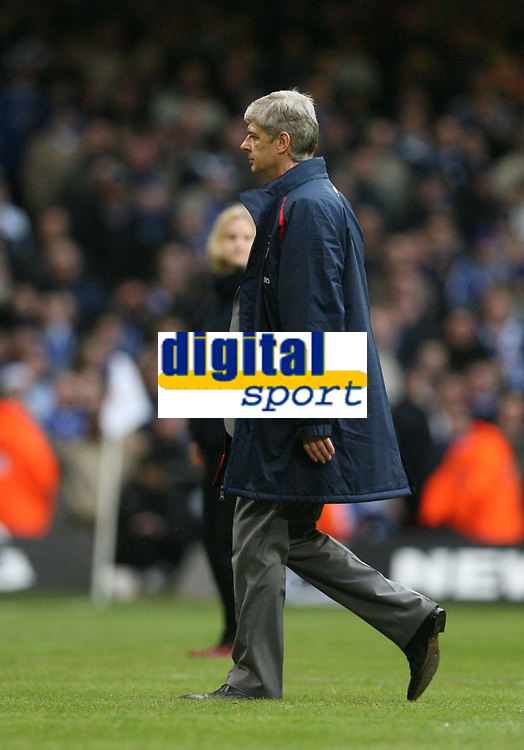 Photo: Rich Eaton.<br /> <br /> Chelsea v Arsenal. Carling Cup Final. 25/02/2007. Arsene Wenger, manager of Arsenal, trudges off the field after seeing 2 of his players red carded, then his team lose 2-1