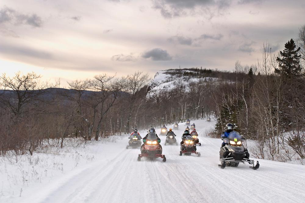 Snowmobilers ride along the top of Brockway Mountain near Copper Harbor on the Keweenaw Peninsula of Michigan's Upper Peninsula.