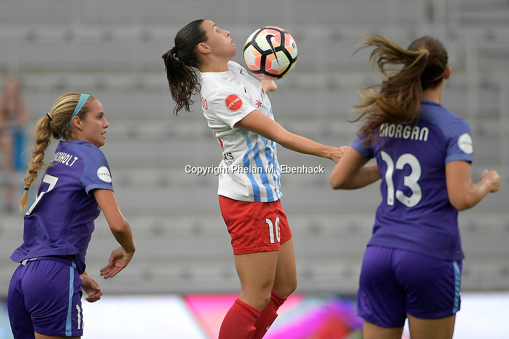Chicago Red Stars' Vanessa Di Bernardo (10) controls a ball between Orlando Pride's Dani Weatherholt, left, and Alex Morgan (13) during the first half of an NWSL soccer match on Saturday, Aug. 5, 2017, in Orlando, Fla. (Photo by Phelan M. Ebenhack)