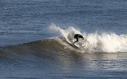 © Licensed to London News Pictures. <br /> 28/12/2014. <br /> <br /> Saltburn, United Kingdom.<br /> <br /> Surfer Robbie Hildreth surfs at Saltburn beach on a freezing cold morning on Teesside.<br /> <br /> Photo credit : Ian Forsyth/LNP