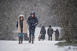 © Licensed to London News Pictures. 24/01/2021. London, UK. People walk in heavy Snowfall on Hampstead Heath in Hampstead in north London. Parts of the UK continue to suffer from flooding caused by Storm Christoph. Photo credit: Ben Cawthra/LNP