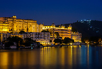 UDAIPUR, INDIA - CIRCA NOVEMBER 2016:  Udaipur City Palace and Lake Pichola at night in Udaipur