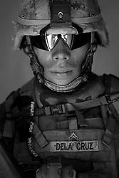 Cpl. Sanick De La Cruz, 23, Chicago, Illinois. Kilo Company, 3rd Battalion, 1st Marine Regiment, 1st Marine Division, United States Marine Corps, at the company's firm base in Hit, Iraq on Friday Sept. 23, 2005.