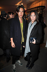 MR EDWARD TANG and MISS VICTORIA TANG at the launch party of 'Songs For Sorrow' hosted by Alber Elbaz and Mika held at Lanvin, 32 Savile Row, London on 11th November 2009.