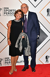Barry Davies (right) and wife Penny during the red carpet arrivals for the BBC Sports Personality of the Year 2018 at The Vox at Resorts World Birmingham.