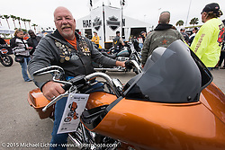 Fred Harwood of Florida tests a 2015 Road Glide at the busy Harley-Davidson display at Daytona International Speedway on the first day of Daytona Beach Bike Week 2015. FL, USA. Saturday, March 7, 2015.  Photography ©2015 Michael Lichter.