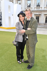 SIR JOHN HURT and his wife ANWEN at the annual Royal Academy of Art Summer Party held at Burlington House, Piccadilly, London on 4th June 2014.