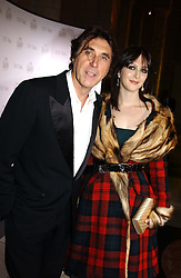 Singer BRYAN FERRY and KATIE TURNER  at the 2004 British Fashion Awards held at Thhe V&A museum, London on 2nd November 2004.<br />