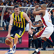 Galatasaray's Preston SHUMPERT (R) and Fenerbahce Ulker's Darjus LAVRINOVIC (L) during their Turkish Basketball league Play Off Final Sixth leg match Galatasaray between Fenerbahce Ulker at the Abdi Ipekci Arena in Istanbul Turkey on Friday 17 June 2011. Photo by TURKPIX