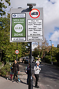 Transport for London's (TFL) new signposts for the new Ultra Low Emissions Zone (ULEZ) have been erected around the inner orbital road perimeter around the capital, and seen on the South Circular in Forest Hill on the day that the new area becomes effective for newer vehicles, on 25th October 2021, in London, England. Now 18 times larger, the new ULEZ area bans older vehicles such as polluting diesels and petrol cars older than 2006, an attempt to lower poisonous emissions that further harm the health of 1 in 10 children who have asthma. Drivers of non-exempt vehicles may enter the ULEZ after paying a £12.50 daily fee - or face a £160 penalty.