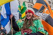 Flags of the counties/regions of Ireland lead the London St Patrick's Day parade from Piccadilly to Trafalgar Square.