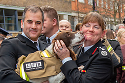 © Licensed to London News Pictures. 23/12/2019. London, UK. London Fire Brigade Commissioner Dany Cotton is licked by a fire investigation dog as a Guard of Honour is held in London. Firefighters from across the UK and several from overseas attended the unofficial event outside the brigades headquarters in Union Street. Commissioner Cotton is retiring in the wake of the Grenfell Fire. Photo credit: Peter Manning/LNP