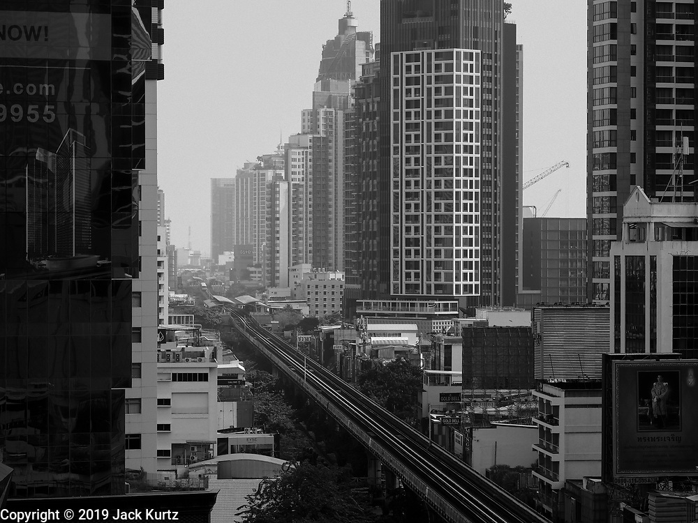 "14 JANUARY 2019 - BANGKOK, THAILAND:       Air pollution obscures the Bangkok skyline looking up Sukhumvit Road. Bangkok has been blanketed by heavily polluted air for almost a week. Monday morning, the AQI (Air Quality Index) for Bangkok  was 182, worse than New Delhi, Jakarta, or Beijing. The Saphan Kwai neighborhood of Bangkok recorded an AQI of 370 and the Lat Yao neighborhood recorded an AQI of 403. An AQI above 50 is considered unsafe. Public health officials have warned people to avoid ""unnecessary"" outdoor activities and wear breathing masks to filter out the dust.    PHOTO BY JACK KURTZ"