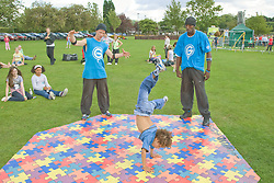Young boy doing a hand stand street dance move during a dance workshop at a Parklife summer activities event,
