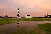 NC01304-00...NORTH CAROLINA - Sunset after a very wet day at Bodie Island Lighthouse reflecting in a puddle; part of Cape Hatteras National Seashore.