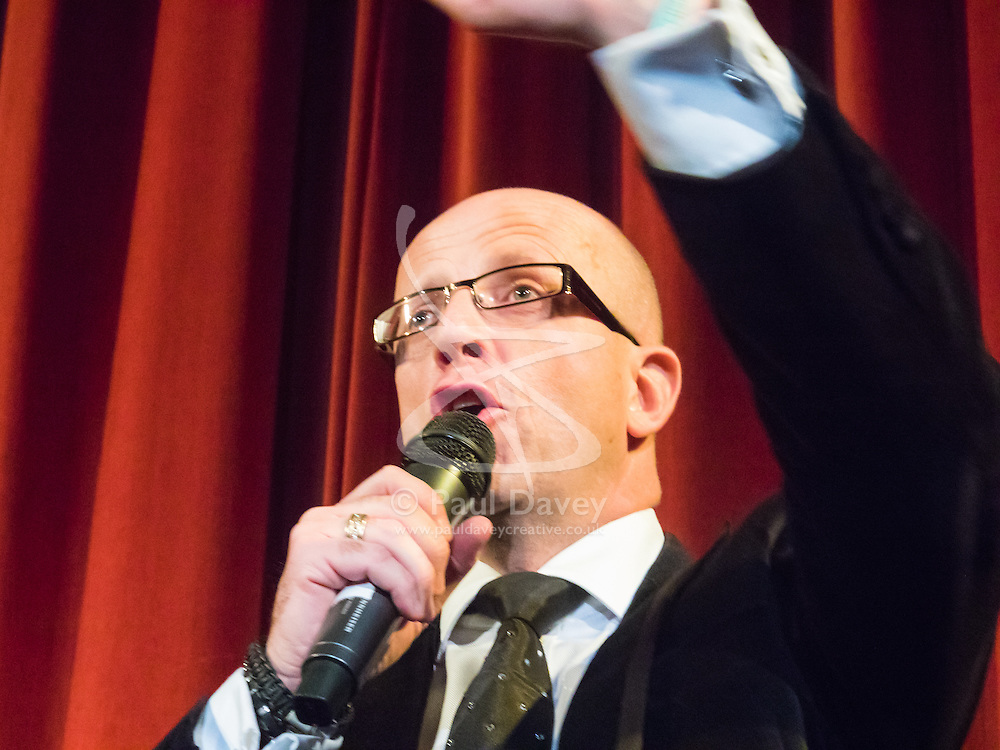 """Old Town Hall, Stratford, London - 28 November 2015. Singers Marc Almond, Ronan Parke, Heather Peace and Asifa Lahore headline the Peter Tatchell Foundation's inaugural Equality Ball, a fundraiser for the foundation's LGBTI and human rights work, with guest of honour Sir Ian McKellen  joined by Michael Cashman. PICTURED: Richard Millar  leads """"Strictly Equality Dancing"""".  //// FOR LICENCING CONTACT: paul@pauldaveycreative.co.uk TEL:+44 (0) 7966 016 296 or +44 (0) 20 8969 6875. ©2015 Paul R Davey. All rights reserved."""