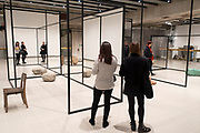 Visitors interacting with artworks at the Space Shifters exhibition at the Hayward Gallery on 16th December 2018 in London, United Kingdom. The exhibit was a major group show of sculptures and installations that explored perception and space, featuring 20 artists. WeltenLinie 2017 by Alicja Kwade.