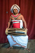 Kandy, Sri Lanka. Musician poses in traditional dress before a performance.