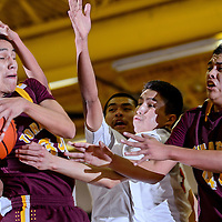 020114       Cable Hoover<br /> <br /> Tohatchi Cougar Marcus Burbank (34) fights the ball away from the Crownpoint Eagles Tuesday at Crownpoint High School.