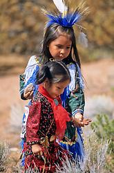 North America, United States, New Mexico, Santa Fe, two girls in traditional Native American regalia