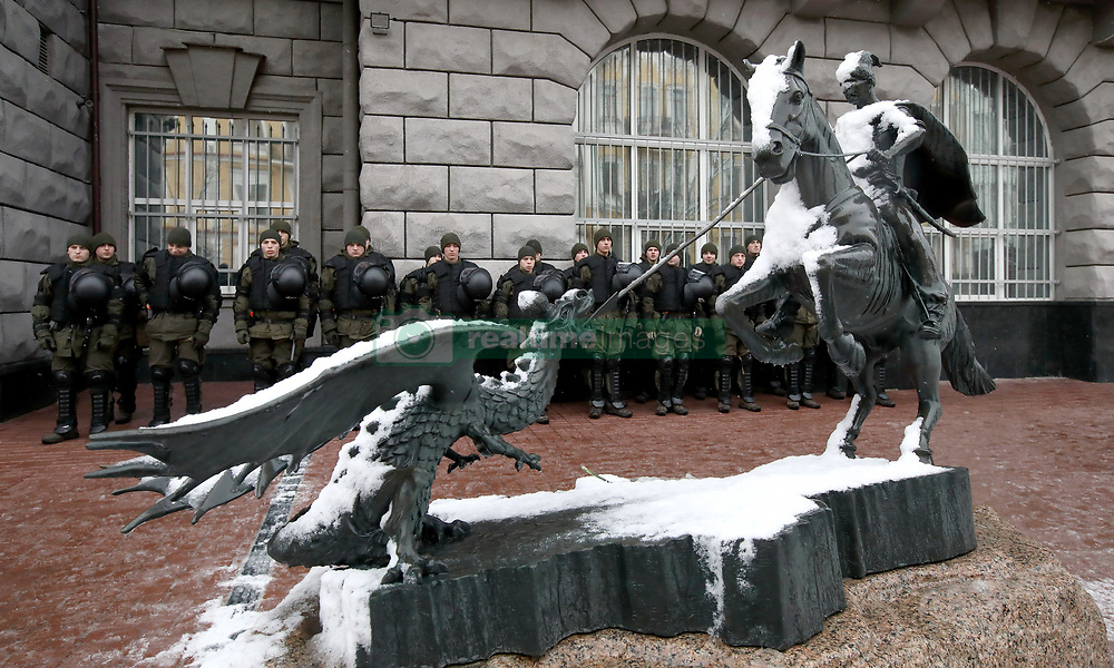 March 27, 2019 - Kyiv, Ukraine - A monument showing a horseman who defeats a dragon is seen in front of the lines of National Guard officers on duty during a protest action of the National Corps and the National Militia outside the Security Service building, Kyiv, capital of Ukraine, March 27, 2019. Ukraine's security agency, commonly known as the SBU, carries out counterintelligence and counterterrorism activities. Ukrinform. (Credit Image: © Tarasov/Ukrinform via ZUMA Wire)