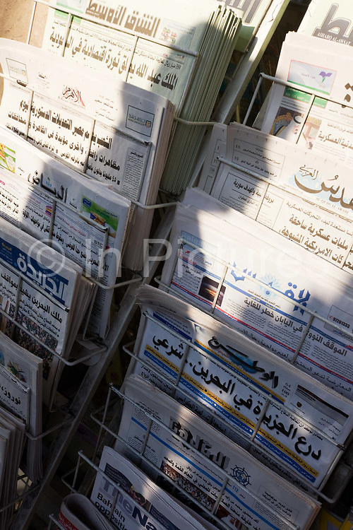 The shadow of a passing pedestrian is cast over Arabic newspapers headlines on sale in a London shop. At a time of social and political upheaval in the states and countries of the Middle-East, news is relished by those living and working in Europe, their favoured news outlets - in addition to online news - is a rich source of impartial reporting. We see the headlines and sub-texts of the media reports that are stacked in a shop's rack near Edgeware Road, a popular hangout for those from Arab countries.