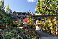 An arbour in the Century Gardens at Deer Lake Park in Burnaby, British Columbia, Canada.  Ceperley House was built in 1911 and has housed the Burnaby Art Gallery since the late 1960's.  The mansion is surrounded by the Century Gardens within the northern border of Deer Lake Park.