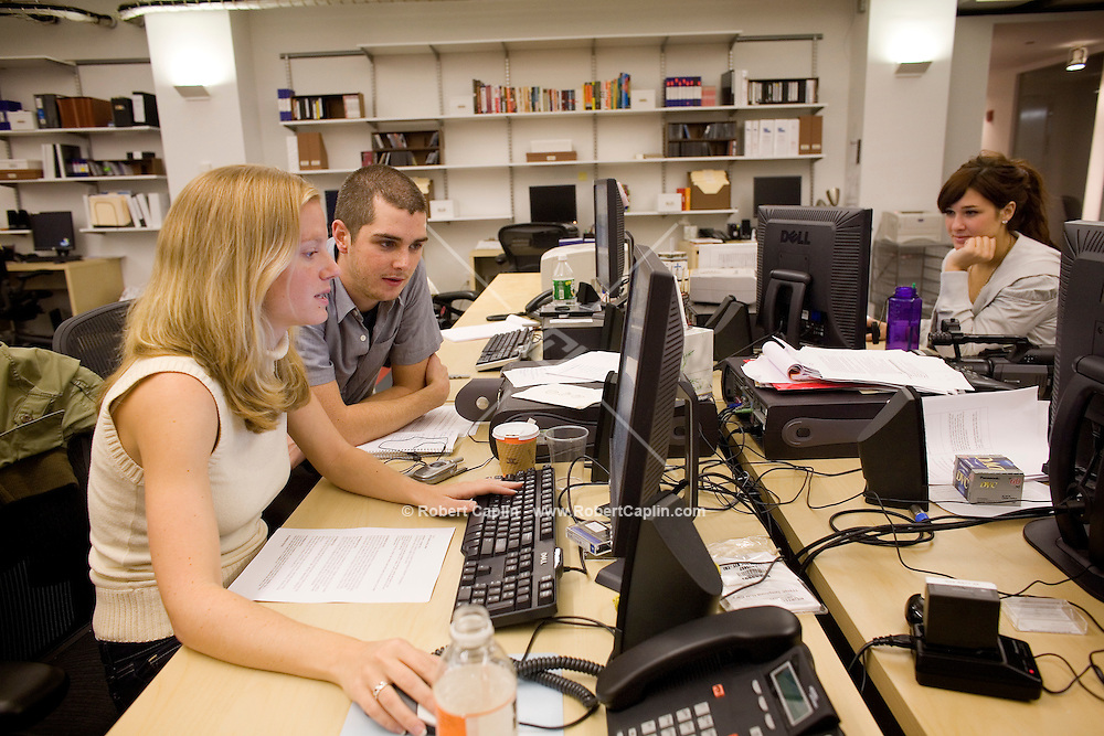 """Producers L to R: Kate Susman, Jared Heinke, Becky Lewis review websites and scripts prior to taping the Friday, Oct. 20 episode of Yahoo!'s """"The 9"""" in their New York studio."""