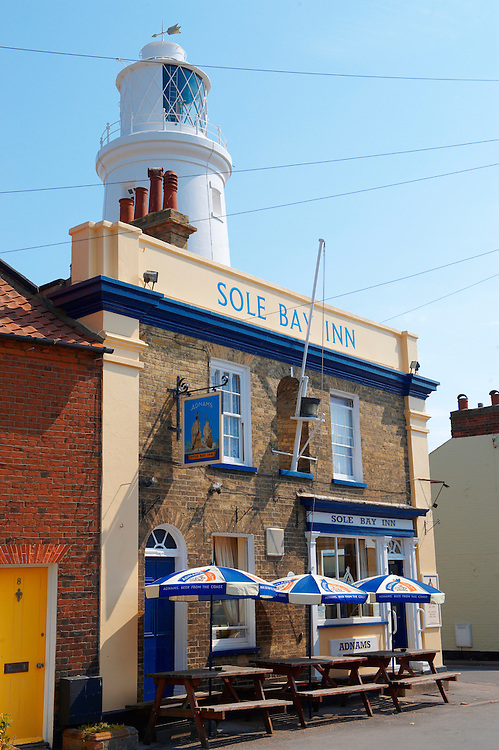 Sole Bay Pub and Lighthouse - Southwold - Suffolk - England .<br /> <br /> Visit our ENGLAND PHOTO COLLECTIONS for more photos to download or buy as wall art prints https://funkystock.photoshelter.com/gallery-collection/Pictures-Images-of-England-Photos-of-English-Historic-Landmark-Sites/C0000SnAAiGINuEQ
