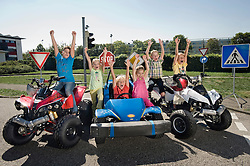 Excited children on driver training area