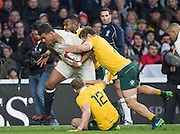 Twickenham, United Kingdom. Nathan HUGHES knock's one Ozzie player  over and carries two more with him, during the Old Mutual Wealth Series Rest Match: England vs Australia, at the RFU Stadium, Twickenham, England, <br /> <br /> Saturday  03/12/2016<br /> <br /> [Mandatory Credit; Peter Spurrier/Intersport-images]