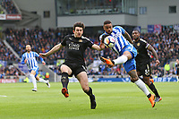 Football - 2017 / 2018 Premier League - Brighton and Hove Albion vs. Leicester City<br /> <br /> Jurgen Locadia of Brighton miss hits a shot whilst under pressure from Harry Miguire of Leicester City at The Amex Stadium Brighton <br /> <br /> COLORSPORT/SHAUN BOGGUST