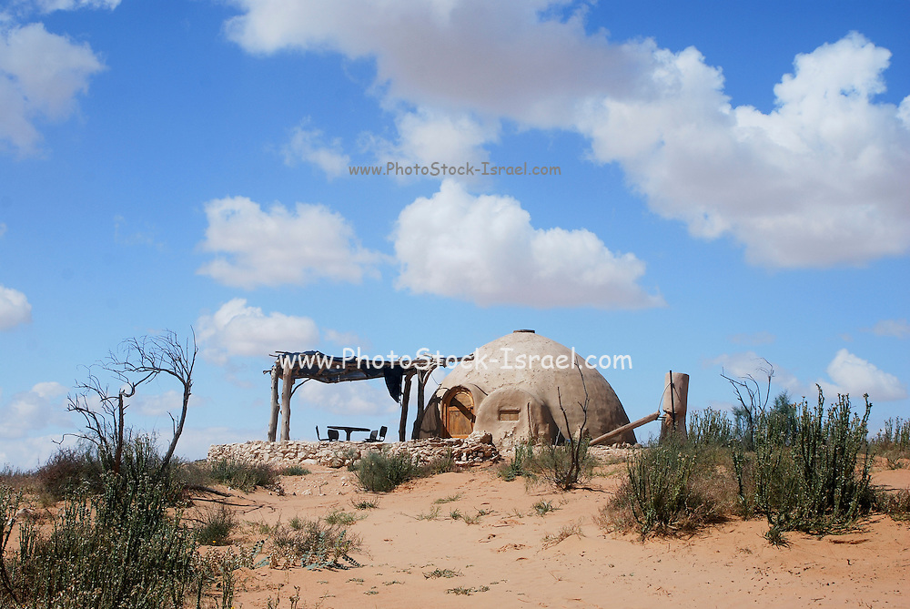 Israel, Negev Desert, Exterior of an Ecological House built from mud and reused materials