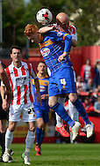 Matt Richards fouls Ryan Woods during the Sky Bet League 2 match between Cheltenham Town and Shrewsbury Town at Whaddon Road, Cheltenham, England on 25 April 2015. Photo by Alan Franklin.