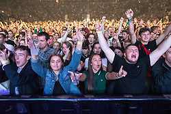 © Licensed to London News Pictures . 09/09/2017. Manchester , UK . The crowd cheer during a minute's applause . We Are Manchester reopening charity concert at the Manchester Arena with performances by Manchester artists including  Noel Gallagher , Courteeners , Blossoms and the poet Tony Walsh . The Arena has been closed since 22nd May 2017 , after Salman Abedi's terrorist attack at an Ariana Grande concert killed 22 and injured 250 . Money raised will go towards the victims of the bombing . Photo credit: Joel Goodman/LNP