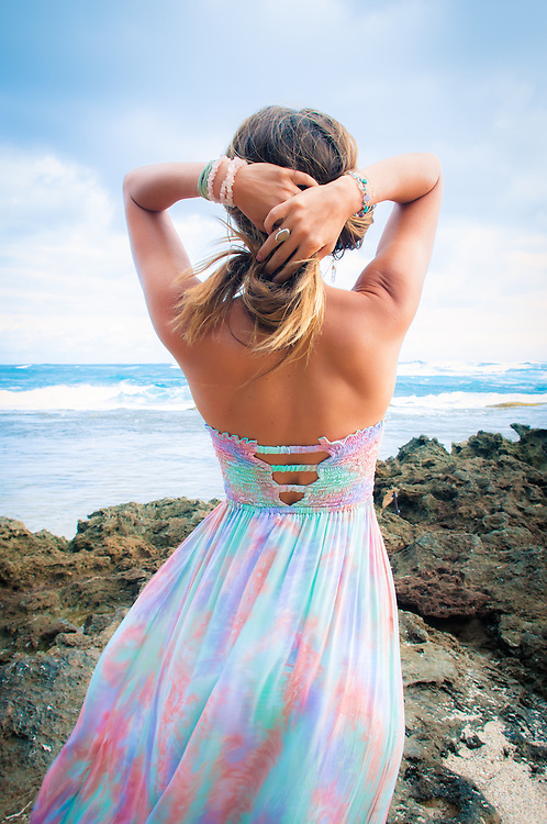 woman looking out over the beach in Hawaii wearing the Tiare Hawaii Over the Rainbow Dress <br /> www.tiarehawaii.com<br /> Model Andrea Hannemann