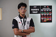 """Backstage security at fighters toilet door<br /><br />MMA. Mixed Martial Arts """"Tigers of Asia"""" cage fighting competition. Top professional male and female fighters from across Asia, Russia, Australia, Malaysia, Japan and the Philippines come together to fight. This tournament takes place in front of a ten thousand strong crowd of supporters in Pelaing Stadium. Kuala Lumpur, Malaysia. October 2015"""